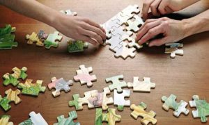 People doing a puzzle